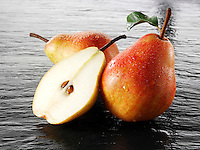 Fresh pears whole and cut with leaves
