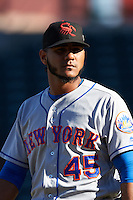 Scottsdale Scorpions pitcher Marcos Molina (45), of the New York Mets organization, walks off the field after a game against the Mesa Solar Sox on October 21, 2016 at Sloan Park in Mesa, Arizona.  Mesa defeated Scottsdale 4-3.  (Mike Janes/Four Seam Images)