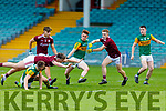 Ruaidhrí Ó Beaglaoich of Kerry under pressure from Tony Gill, Sean Fitzgerald and Jonathan McGrath of Galway as he attempted to raise the green flag in the U20 All Ireland football semi   final.