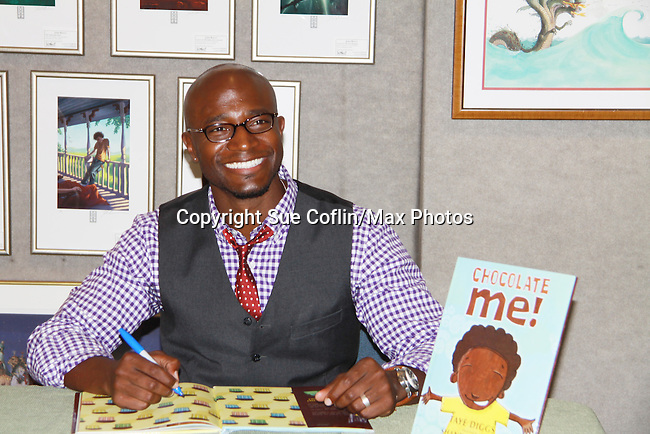 """Taye Diggs (Guiding Light """"Adrian Sugan Hill"""", Private Practice, Rent) is the author of Chocolate Me! at a launch party to celebrate their first picture book together on September 28, 2011 at Books of Wonder, New York City, New York. Taye read the book to the audience. (Photo by Sue Coflin/Max Photos)"""