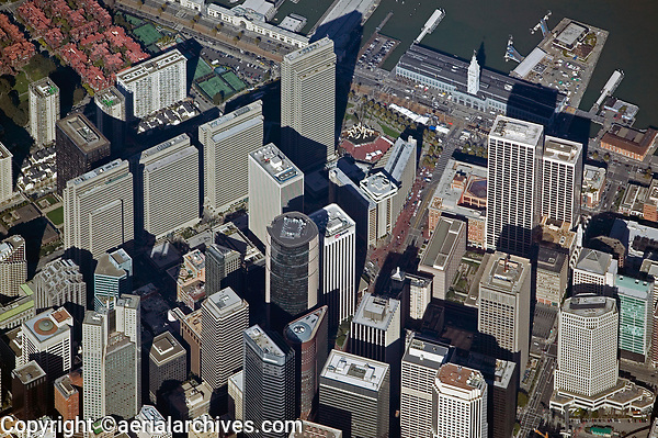 aerial photograph of an overview of the San Francisco financial district which shows the Market Street and the Embarcadero at the Ferry Building and many of San Francisco's high rises including, Embarcadero Center, 333 Bush, One Market Plaza, including the Landmark, Spear Street Tower and the Steuart Street Tower, the Embarcadero Center, he Hyatt Regency Hotel, 101 California Street, and numerous other skyscrapers, San Francisco, California
