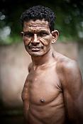 Santu Usenti poses for a photograph in village Godhari in Orcha block of Chattisgarh, India. Photo: Sanjit Das