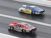 Apr. 7, 2013; Las Vegas, NV, USA: NHRA pro stock driver Rodger Brogdon (far lane) races alongside V. Gaines during the Summitracing.com Nationals at the Strip at Las Vegas Motor Speedway. Mandatory Credit: Mark J. Rebilas-