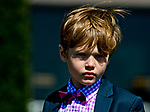 LEXINGTON, KENTUCKY - APRIL 07: A young boy watches horses in the paddock before an undercard race on opening day at Keeneland Race Course on April 7, 2017 in Lexington, Kentucky. (Photo by Scott Serio/Eclipse Sportswire/Getty Images)