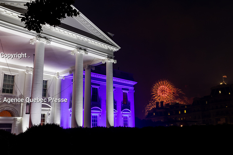 Salute to America 2020<br /> <br /> The White House North Portico is lit in red-white and blue lights Saturday evening, July 4, 2020, during the Salute to America 2020, Fourth of July celebration. (Official White House Photo by Katie Ricks)