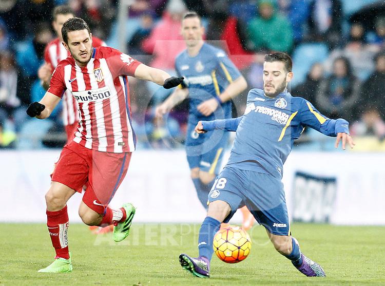 Getafe's Victor Rodriguez (r) and Atletico de Madrid's Koke Resurrecccion during La Liga match. February 14,2016. (ALTERPHOTOS/Acero)