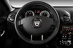 Steering wheel view of a 2010 Dacia Duster 4 Door SUV
