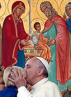 Papa Francesco bacia un bambino al suo arrivo all'incontro con le famiglie in Piazza San Pietro, Citta' del Vaticano, 26 ottobre 2013.<br /> Pope Francis kisses a child as he arrives for a meeting with families in St. Peter's Square at the Vatican, 26 October 2013.<br /> UPDATE IMAGES PRESS/Riccardo De Luca<br /> <br /> STRICTLY ONLY FOR EDITORIAL USE