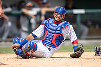South Bend Cubs catcher Eric Gonzalez (20) grimaces in pain after getting hit behind the plate against the Lake County Captains on May 30, 2019 at Four Winds Field in South Bend, Indiana. The Captains defeated the Cubs 5-1.  (Andrew Woolley/Four Seam Images)