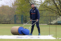 Zain Shahzad of Wanstead CC attempts to dry the playing area after heavy rain fell ahead of Wanstead and Snaresbrook CC vs Hornchurch CC, Hamro Foundation Essex League Cricket at Overton Drive on 8th May 2021