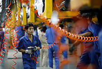 Workers at the Geely automobile factory work on the assembly line at the company's site in Ningbo, China. ©Qilai Shen/Sinopix