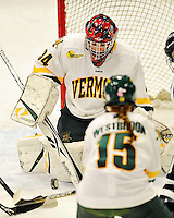 11 February 2011: University of Vermont Catamount goaltender Roxanne Douville, a Freshman from Beloeil, Quebec, makes a save against the University of New Hampshire Wildcats at Gutterson Fieldhouse in Burlington, Vermont. The Lady Catamounts defeated the visiting Lady Wildcats 4-2 in Hockey East play. Mandatory Credit: Ed Wolfstein Photo