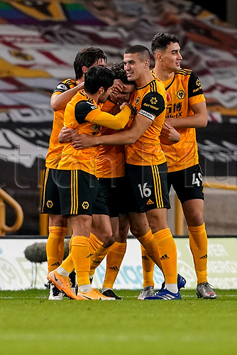 30th October 2020; Molineux Stadium, Wolverhampton, West Midlands, England; English Premier League Football, Wolverhampton Wanderers versus Crystal Palace; Wolverhampton Wanderers team celebrate Rayan Aït-Nouri scoring the first goal in the 16th minute for a 1-0 lead