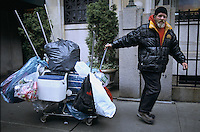 New York, New York. A homeless man collecting cans on the upper west side.