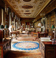 The 17th century ceiling of the library features roundels by Verrio. Much of the furniture in the room came from Devonshire House