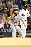 Toronto Blue Jays first baseman Adam Lind (26) stretches for a throw during a game against the Chicago White Sox on August 15, 2014 at U.S. Cellular Field in Chicago, Illinois.  Chicago defeated Toronto 11-5.  (Mike Janes/Four Seam Images)