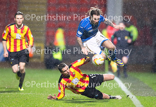 Partick Thistle v St Johnstone....21.01.14   SPFL<br /> Stevie May is brought down by Lee Mair<br /> Picture by Graeme Hart.<br /> Copyright Perthshire Picture Agency<br /> Tel: 01738 623350  Mobile: 07990 594431