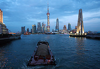 The Pudong Financial District seen from a bridge in evening in Shanghai, China..