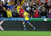 Saturday 28 September 2013<br /> Pictured: Aaron Ramsey of Arsenal celebrating his goal.<br /> Re: Barclay's Premier League, Swansea City FC v Arsenal at the Liberty Stadium, south Wales.