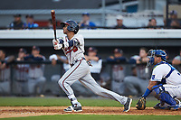Juan Morales (1) of the Danville Braves follows through on his swing against the Burlington Royals at Burlington Athletic Stadium on July 13, 2019 in Burlington, North Carolina. The Royals defeated the Braves 5-2. (Brian Westerholt/Four Seam Images)