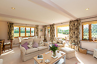 BNPS.co.uk (01202 558833)<br /> Pic: Savills/BNPS<br /> <br /> Pictured: The spacious living room with access to the garden.<br /> <br /> A historic thatched home where Cromwell's army stayed during the English Civil War is on the market for £1.6m.<br /> <br /> The Barracks, so-named for its links with Cromwell more than 370 years ago, has spectacular country views and is in one of Cheshire's most popular areas.<br /> <br /> The five-bedroom property just outside the picturesque village of Bunbury is a far cry from how it would have looked in Cromwell's time, having been extended over the years.<br /> <br /> It was used in the 17th century by Cromwell's armies during the siege of Beeston Castle - two miles away. The castle's location made it valuable to both the royalists and parliamentarians.