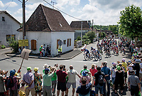 peloton rolling through town<br /> <br /> Stage 19 from Mourenx to Libourne (207km)<br /> 108th Tour de France 2021 (2.UWT)<br /> <br /> ©kramon