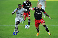 WASHINGTON, DC - NOVEMBER 8: Erick Sorga #50 of D.C. United battles for the ball with Zachary Brault-Guillard #15 of Montreal Impact during a game between Montreal Impact and D.C. United at Audi Field on November 8, 2020 in Washington, DC.