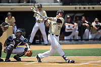 Gavin Sheets (24) of the Wake Forest Demon Deacons follows through on his swing against the Pitt Panthers at David F. Couch Ballpark on May 20, 2017 in Winston-Salem, North Carolina. The Demon Deacons defeated the Panthers 14-4.  (Brian Westerholt/Four Seam Images)