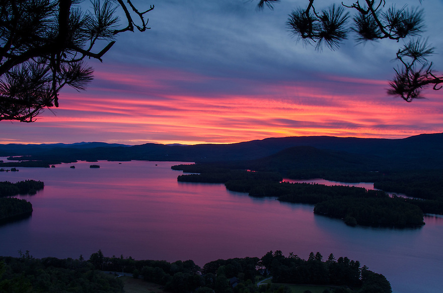 Another spectacular sunset unfolds over Squam Lake in New Hampshire's Lakes Region.
