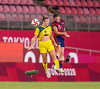 KASHIMA, JAPAN - AUGUST 5: Caitlin Foord #9 of Australia goes up for a header with Kelley O'Hara #5 of the USWNT during a game between Australia and USWNT at Kashima Soccer Stadium on August 5, 2021 in Kashima, Japan.