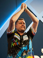 21.12.2014.  London, England.  William Hill World Darts Championship.  Kevin Painter (20) [ENG] makes his way on stage for his match against Boris Koltsov [RUS]