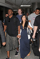 MIAMI - FL- DECEMBER 31, 2007: (EXCLUSIVE COVERAGE) Kim Kardashian ( Keeping Up With The Kardashians) finally takes her relationship public with NFL star Reggie Bush (New Orleans Saints).  The couple arrived  at Miami International Airport, they looked  very happy and were holding hands. Reggie soon became somewhat irritated and very protective of Kim when the couple were surrounded by autograph seekers.  <br /> <br /> People;  Kim Kardashian; Reggie Bush