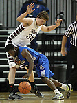 Desert Pines' Malik Davis tries to push past Elko defender Brian Pearson during the NIAA basketball state tournament at Lawlor Events Center, in Reno, Nev., on Friday, Feb. 28, 2014. Elko won 63-47 to advance to the state championship game. (Cathleen Allison/Las Vegas Review-Journal)