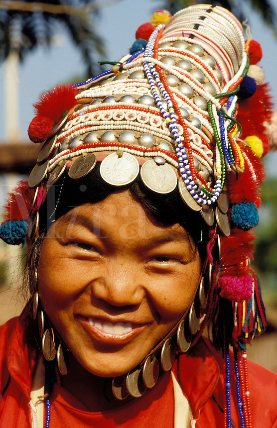 Thailand. North of Chieng Mai / Chiang Mai.  Girl of Akha tribe in traditional dress