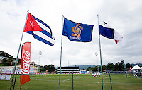 The flags of the participating countries and CONCACAF fly over the field during the group stage of the CONCACAF Men's Under 17 Championship at Jarrett Park in Montego Bay, Jamaica. Panama tied Cuba, 0-0.