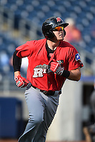 Frisco Rough Riders third baseman Ryan Rua (9) runs to first watching his home run during the first game of a doubleheader against the Tulsa Drillers on May 29, 2014 at ONEOK Field in Tulsa, Oklahoma.  Frisco defeated Tulsa 13-4.  (Mike Janes/Four Seam Images)