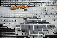Workers installing  the solar panels on the Petronas Towers, Kuala Lumpur, Malaysia. The Petronas Towers are some of the highest building in the world, they are 452 meters tall..02-Nov-11..................The Petronas Towers, Kuala Lumpur, Malaysia,.02-Nov-11..................Solar power panels are installed on a roof-top in the CBD (Central Business District) , Kuala Lumpur, Malaysia,.01-Nov-11..................Solar power panels are installed on a roof-top in the CBD (Central Business District) , Kuala Lumpur, Malaysia,.01-Nov-11..................Solar panels are installed on the roof of a building in the Kula Lumpur business district, Malaysia. Green technology is increasingly being adopted in Asia as new buildings come online green technology is often incorprerated in the design.02-Nov-11.............