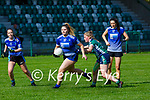 Maggie West Laune Rangers is tackled by Kiah Doona Legion during their Junior A Championship game in Direen on Sunday