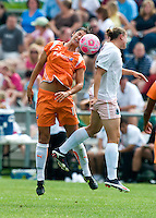 Sky Blue FC  midfielder Yael Averbuch (10) goes up for a ball against St. Louis Athletica forward Christie Welsh (23) during a WPS match at Anheuser-Busch Soccer Park, in St. Louis, MO, June 7 2009.  Athletica won the match 1-0.