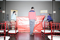 Campaign workers put away campaign materials and banners after Republican presidential candidate Carly Fiorina spoke at a town hall campaign event at LaBelle Winery in Amherst, New Hampshire.