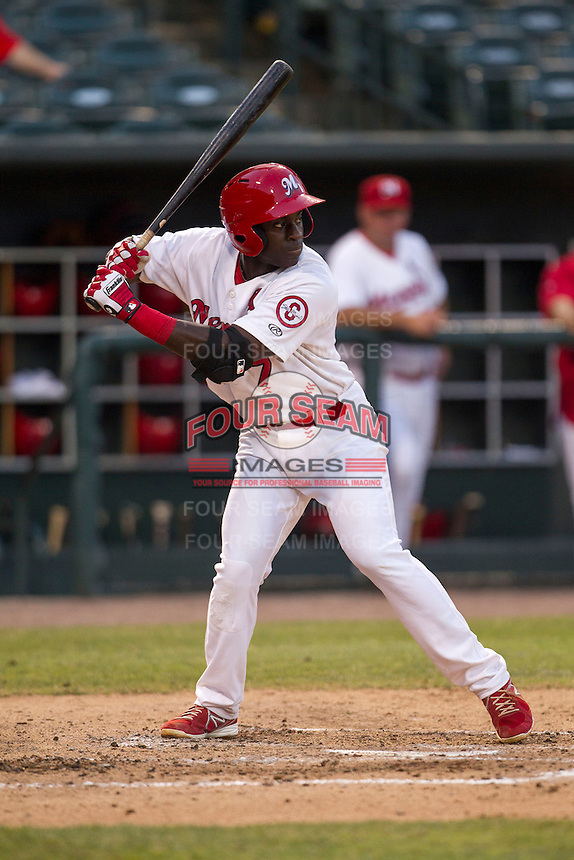Memphis Redbirds third baseman Jermaine Curtis (7) at bat against the New Orleans Zephyrs in the Pacific Coast League baseball game on June 12, 2013 at Autozone Park in Memphis, Tennessee. Memphis defeated New Orleans 9-3. (Andrew Woolley/Four Seam Images)