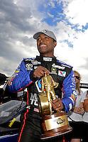 Jul, 22, 2012; Morrison, CO, USA: NHRA top fuel dragster driver Antron Brown celebrates after winning the Mile High Nationals at Bandimere Speedway. Mandatory Credit: Mark J. Rebilas-