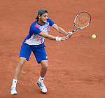 Joao Sousa (POR) falls behind Novak Djokovic (SRB) 6-1, 6-2 after two sets and a rain delay at  Roland Garros being played at Stade Roland Garros in Paris, France on May 26, 2014