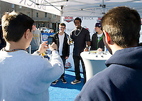 Former Michigan linebacker Dhani Jones greets fans during Sugar Bowl Fan Fest 2012 in the French Quarters in New Orleans, Louisiana on January 2nd, 2012.