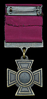 BNPS.co.uk (01202) 558833. <br /> Pic: DixNoonanWebb/BNPS<br /> <br /> Pictured: The rear of the Victoria Cross awarded to Private James Towers. <br /> <br /> The Victoria Cross awarded to a soldier who volunteered for a suicidal mission after seeing five comrades killed attempting it has today sold for £248,000.<br /> <br /> Private James Towers bravely stepped forward as the sixth man to dash out in front of enemy machine gun posts and try to get a vital message to a cut-off platoon 150 yards away.<br /> <br /> He did this despite witnessing the five previous runners - including his best friend - get cut to pieces.<br /> <br /> Pte Towers, whose medals were sold with Dix Noonan Webb, miraculously survived the mission at Mericourt on the Western Front in the final months of World War One.