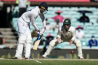 10th January 2021; Sydney Cricket Ground, Sydney, New South Wales, Australia; International Test Cricket, Third Test Day Four, Australia versus India; Shubman Gill of India plays  a shot as Matthew Wade of Australia waits for a catch