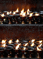 Images from the Book Journey Through Colour and Time,.Butterlamps being kept inside a special building usually very close or right at the Temple,Lhasa, Tibet.The Jokhang Temple is one of Tibet's holiest shrines, originally built in 647 A.D. in celebration of the marriage of the Tang Princess Wencheng and the Tubo King Songtsen Gampo. In front of the gate is a stone Tablet of Unity from the Tang Dynasty; inscribed are both Chinese characters and Tibetan script. Nearby is the stump of the willow tree said to have been planted by Princess Wencheng herself; two younger willow trees now flank the stump of the first tree...Located in the center of old Lhasa, the temple was built by craftsmen from Tibet, China, and Nepal and thus features different architectural styles. The temple is also the spiritual center of Tibet and the holiest destination for all Tibetan Buddhist pilgrims. In the central hall is the Jokhang's oldest and most precious object--a gold statue of a seated 12-year-old Sakyamuni. This is said to have been transported to Tibet by Princess Wencheng from her home in Changan in 700 A.D. Other precious antiques in the temple include a silk portrait of Buddha from the Tang Dynasty and a pearl gown and gold lamp from the Ming Dynasty. The three-leafed roof of the Jokhang offers splendid views of the bustling Barkhor market and across to the Potala Palace..