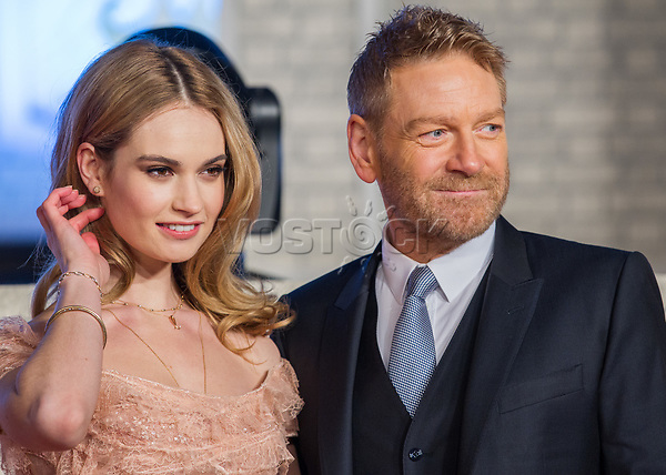 epa04695364 British actress and cast member Lily James (L) and British film director Kenneth Branagh (R) pose for photographers during the Japan premiere of the movie 'Cinderella' in Tokyo, Japan, 08 April 2015. The movie will be released in theaters across Japan on 25 April.  EPA/CHRISTOPHER JUE