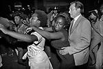 Conga Line dancing Notting Hill Carnival 1981. Older white male too close to black female taking part in the black community Conga Line Dance. 1980s UK