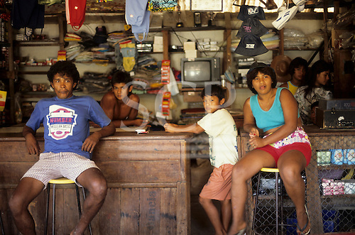 Roraima State, Brazil. Family in a rural bar with television.